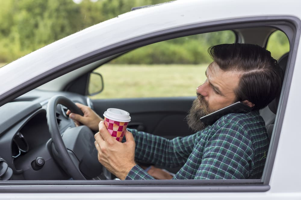 distracted driver drinking coffee